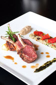 Australian lamb roasted with herbs , couscous and mutabbel — Stock Photo