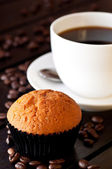 Coffee with a muffin on table close up — Stock Photo