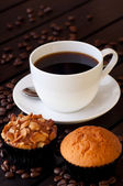 Coffee with two muffin on table close up — Stock Photo
