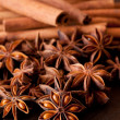 Star anise and cinnamon close up on wooden table — Stock Photo