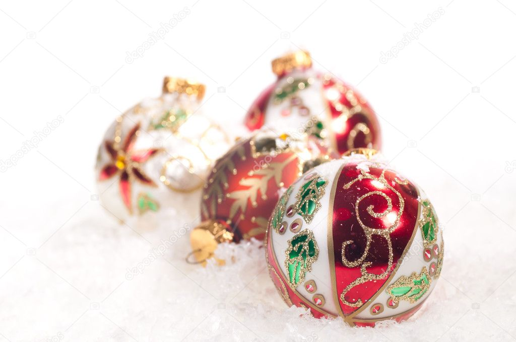 Colourful hand painted  glass baubles on snow — Stockfoto #12013714