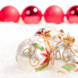 White glass baubles and a line of red baubles in the background - Stock Photo
