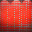 Red brick wall background with beams of light — Stock Photo