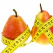 Stock Photo: Two pears with tape measure on waistes.