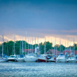 Boats in the harbor of Mikolajki at sunset — Stock Photo