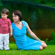 Cute two years old boy with his young mom in park — Stock Photo #11011717