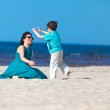 Mother and son having fun beach vacation — Stock Photo #11011737