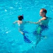 Royalty-Free Stock Photo: Father teaching his little son to swim