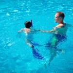 Father teaching his little son to swim — Stock Photo