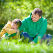 Stock Photo: Cute little boy hugs his father outdoors