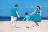 Young family of three having fun tropical beach — Stock Photo