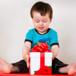 Happy toddler boy opening gift box — Stock Photo