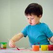 Cute toddler boy painting with brush — Stock Photo #11048562