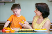 Cute little boy refuses to taste muffin — Stock Photo