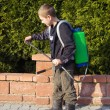 Boy prepared sprayer — Stock Photo