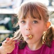 Stock Photo: Eating little girl