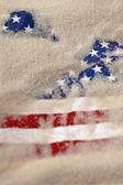 Buried american flag — Stock Photo