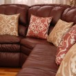Pillows on a leather sofa - Foto Stock