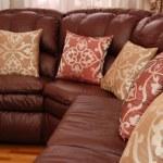Pillows on a leather sofa — Stock Photo #10769612