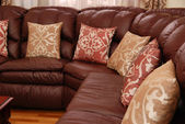 Pillows on a leather sofa — Stock Photo