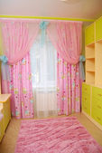 Pink curtains in a nursery — Stock Photo