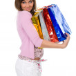 Beautiful brunette with packages on hands — Stock Photo