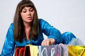 The girl looks in packages — Stock Photo