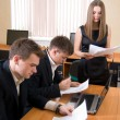 Stock Photo: Team of young works with documents