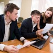 Team of young works with documents — Stock Photo