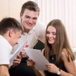 Group of young, cheerful partners in business — Stock Photo
