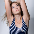 Stock Photo: Beautiful girl with lifted elbows looks upward