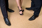 Feet of business standing on the floor — Stock Photo