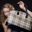 Beautiful blonde lifted bag — Stock Photo #11796474