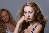 Two blondes on a gray background — Stock Photo