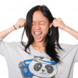 Stock Photo: Girl pulls ears and shouts