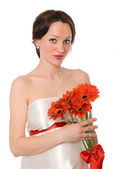 Pregnant woman with a bunch of flowers — Stock Photo