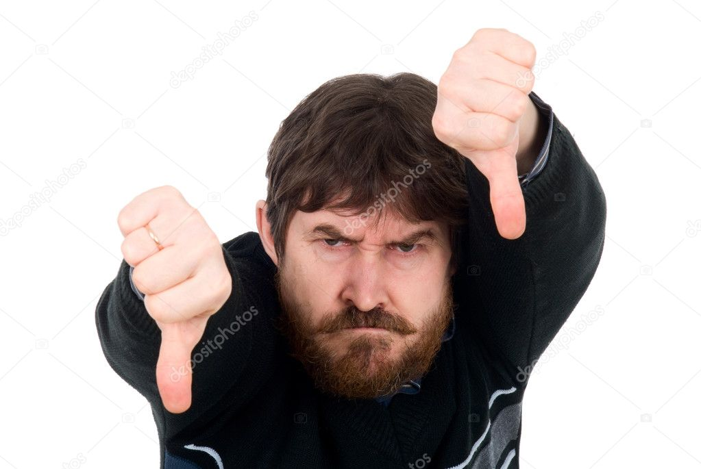 Portrait of the bearded man showing thumbs down. Isolated on a white background  Stock Photo #12077556
