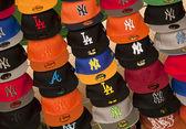 Baseball caps on market stall — Stock Photo