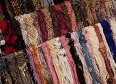 Multicoloured scarves on market — Stock Photo