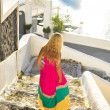 Vacationing young beautiful woman in a beautiful dress in Santorini, Greece, Near Cruise Ship — ストック写真