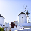Traditional white windmill  in Oia, Santorini island, Greece — Stock Photo