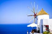 Traditional white windmill in Oia, Santorini island, Greece — Stock Photo