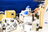 Santorini traditional blue and white village and church in Oia and sea view , Greece — Stock Photo