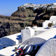 Santorini traditional blue and white village and church in Oia and sea view , Greece — Stock Photo #11959149