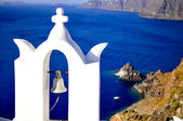 Santorini traditional church with a bell in Oia , Greece — Stock Photo