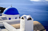 Santorini traditional white and blue church in Oia , Greece — Stock Photo