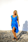 Young vacationing beautiful happy girl in blue dress In Santorini — Stock Photo
