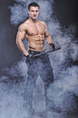 Good looking policeman bodybuilder posing — Stock Photo