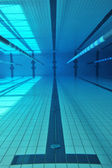 Swimming pool underwater — Stock Photo