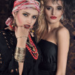 Portrait of gorgeous gypsy woman with another women - Stock Photo